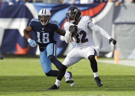 Baltimore Ravens free safety Eric Weddle (32) intercepts a pass intended for Tennessee Titans wide receiver Rishard Matthews (18) in the second half of an NFL football game Sunday, Nov. 5, 2017, in Nashville, Tenn.