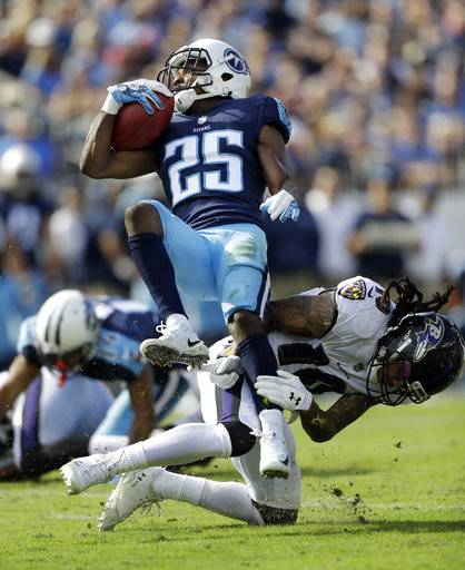 Tennessee Titans cornerback Adoree' Jackson (25) is brought down by Baltimore Ravens wide receiver Chris Moore (10) in the first half of an NFL football game Sunday, Nov. 5, 2017, in Nashville, Tenn.
