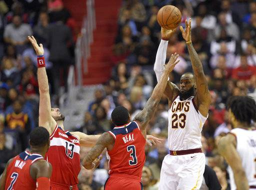 Cleveland Cavaliers forward LeBron James (23) passes against Washington Wizards center Marcin Gortat (13), of Poland, guard Bradley Beal (3), and guard John Wall (2) during the second half of an NBA basketball game, Friday, Nov. 3, 2017, in Washington.