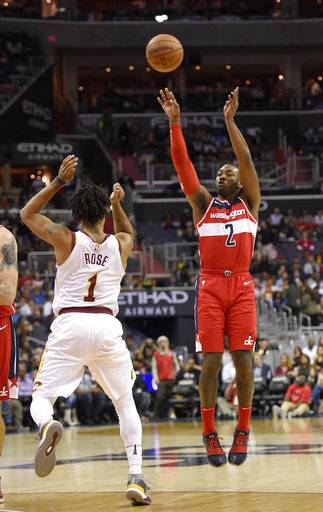 Washington Wizards guard John Wall (2) shoots against Cleveland Cavaliers guard Derrick Rose (1) during the second half of an NBA basketball game, Friday, Nov. 3, 2017, in Washington.