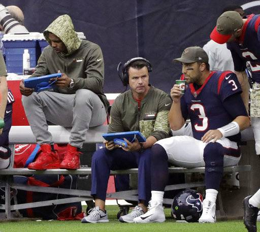 Injured Houston Texans quarterback Deshaun Watson, front  left, sits on the bench with quarterback Tom Savage (3) during the first half of an NFL football game against the Indianapolis Colts, Sunday, Nov. 5, 2017, in Houston.