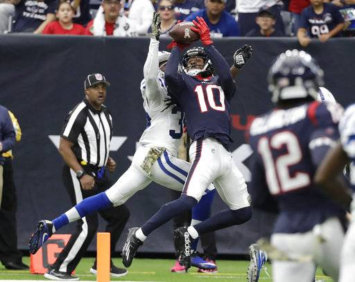 Houston Texans wide receiver DeAndre Hopkins (10) pulls in a 34-yard catch for a touchdown in front of Indianapolis Colts cornerback Pierre Desir (35) during the second half of an NFL football game Sunday, Nov. 5, 2017, in Houston.