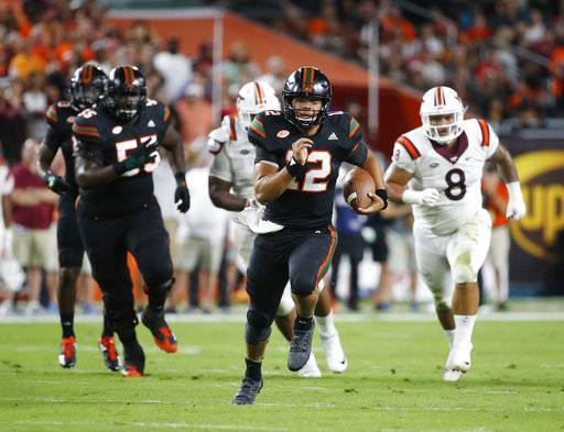 Miami quarterback Malik Rosier (12) runs for yardage during the first half of an NCAA College football game against Virginia Tech, Saturday, Nov. 4, 2017 in Miami Gardens, Fla.