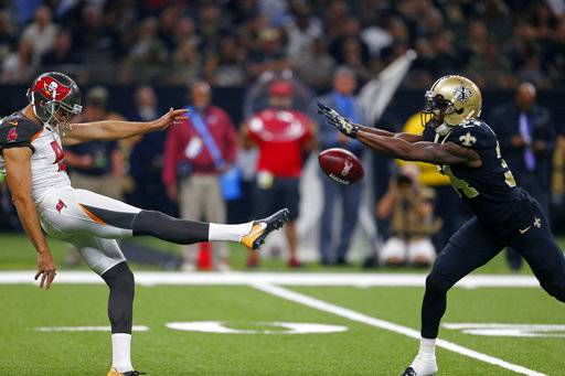 New Orleans Saints defensive back Justin Hardee (34) blocks a punt by Tampa Bay Buccaneers punter Bryan Anger, which Hardee returned for a touchdown, in the first half of an NFL football game in New Orleans, Sunday, Nov. 5, 2017.
