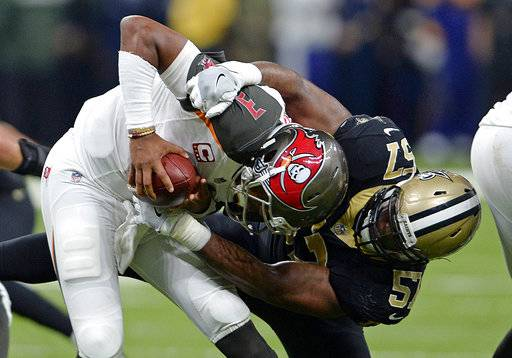 Tampa Bay Buccaneers quarterback Jameis Winston tries to avoid the sack by New Orleans Saints defensive end Alex Okafor (57) in the first half of an NFL football game in New Orleans, Sunday, Nov. 5, 2017.