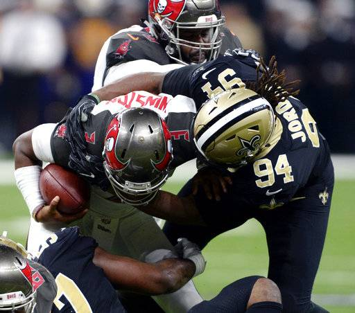 Tampa Bay Buccaneers quarterback Jameis Winston (3) is sacked by New Orleans Saints defensive end Cameron Jordan (94) in the first half of an NFL football game in New Orleans, Sunday, Nov. 5, 2017.