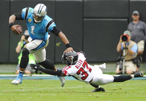 Carolina Panthers' Cam Newton (1) runs past Atlanta Falcons' Ricardo Allen (37) in the first half of an NFL football game in Charlotte, N.C., Sunday, Nov. 5, 2017.