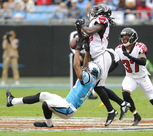 Carolina Panthers' Russell Shepard (19) tries in vain for a catch as Atlanta Falcons' Desmond Trufant (21) defends in the first half of an NFL football game in Charlotte, N.C., Sunday, Nov. 5, 2017.