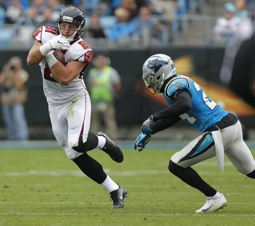Atlanta Falcons' Austin Hooper (81) runs after a catch as Carolina Panthers' James Bradberry (24) defends in the first half of an NFL football game in Charlotte, N.C., Sunday, Nov. 5, 2017.