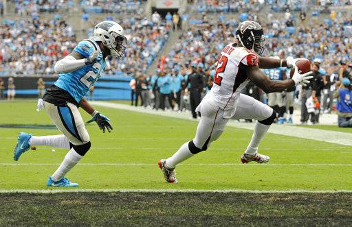 Atlanta Falcons' Mohamed Sanu (12) runs past Carolina Panthers' Daryl Worley (26) for a touchdown in the first half of an NFL football game in Charlotte, N.C., Sunday, Nov. 5, 2017.