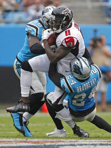 Atlanta Falcons' Julio Jones (11) is tackled by Carolina Panthers' James Bradberry (24) and Thomas Davis (58) in the first half of an NFL football game in Charlotte, N.C., Sunday, Nov. 5, 2017.