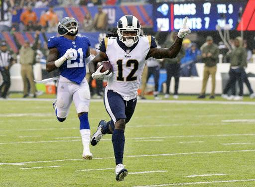 Los Angeles Rams' Sammy Watkins (12) runs from New York Giants' Landon Collins (21) for a touchdown during the first half of an NFL football game Sunday, Nov. 5, 2017, in East Rutherford, N.J.
