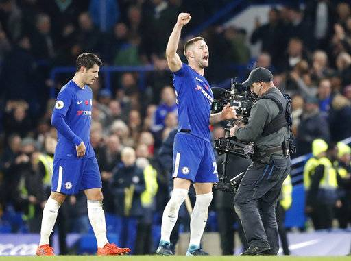 Chelsea's Gary Cahill, right, and Chelsea's Alvaro Morata celebrate after winning the English Premier League soccer match between Chelsea and Manchester United at Stamford Bridge stadium in London, Sunday, Nov. 5, 2017.