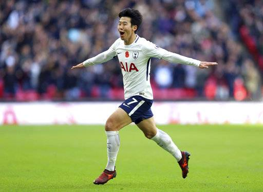 Tottenham Hotspur's Son Heung-Min celebrates scoring his side's first goal of the game, during the English Premier League soccer match between Tottenham Hotspur and Crystal Palace, at Wembley Stadium, in London, Sunday, Nov. 5, 2017. (Nigel French/PA via AP)