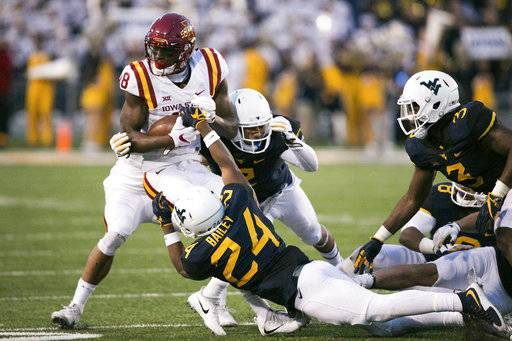 Iowa State wide receiver Hakeem Butler (18) is brought down by West Virginia's Hakeen Bailey (24) during the second half of an NCAA college football game in Morgantown, W.Va., on Saturday, Nov. 4, 2017.