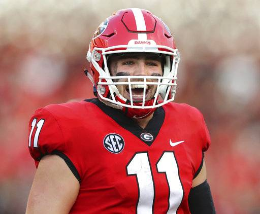 Georgia quarterback Jake Fromm smiles after his touchdown pass to wide receiver Mecole Hardman against South Carolina during the third quarter during an NCAA college football game Saturday, Nov. 4, 2017, in Athens, Ga. (Curtis Compton/Atlanta Journal Constitution via AP)