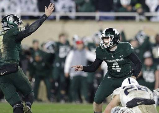 Michigan State place kicker Matt Coghlin (4) looks towards holder Brian Lewerke after kicking the game winning field goal with seconds remaining to defeat Penn State 27-24 in an NCAA college football game, Saturday, Nov. 4, 2017, in East Lansing, Mich.