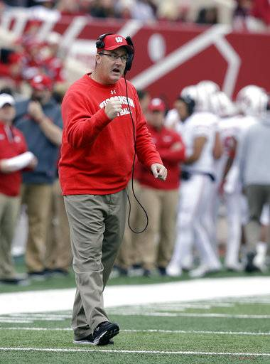 Wisconsin head coach Paul Chryst encourages his team during the second half of an NCAA college football game against Indiana, Saturday, Nov. 4, 2017, in Bloomington, Ind. Wisconsin won 45-17.