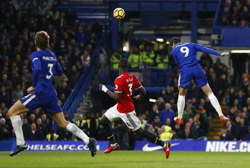 Chelsea's Alvaro Morata, right, scores his sides first goal during the English Premier League soccer match between Chelsea and Manchester United at Stamford Bridge stadium in London, Sunday, Nov. 5, 2017.