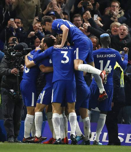 Chelsea players celebrate their sides first goal during the English Premier League soccer match between Chelsea and Manchester United at Stamford Bridge stadium in London, Sunday, Nov. 5, 2017.