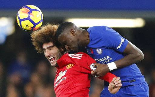 Manchester United's Marouane Fellaini, left, and Chelsea's Antonio Ruediger challenge for the ball during the English Premier League soccer match between Chelsea and Manchester United at Stamford Bridge stadium in London, Sunday, Nov. 5, 2017.