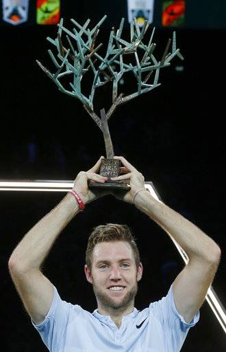 Jack Sock of the United States holds the trophy after he defeated Filip Krajinovic of Serbia during their final match of the Paris Masters tennis tournament at the Bercy Arena in Paris, France, Sunday, Nov. 5, 2017.