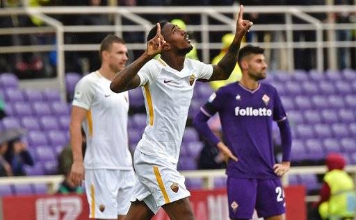 Roma's Gerson celebrates after scoring a goal during the Italian Serie A soccer match between Fiorentina and Roma at the Artemio Franchi stadium in Florence, Italy, Sunday, Nov. 5, 2017. (Maurizio Degl'Innocenti/ANSA via AP)