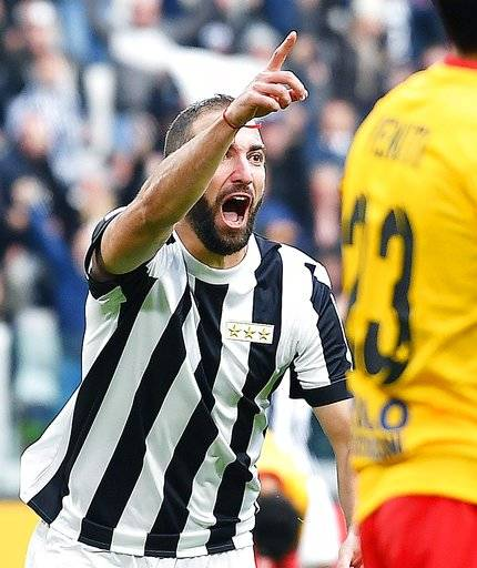 Juventus' Gonzalo Higuain celebrates scoring a goal during the Italian Serie A soccer match between Juventus and Benevento at the Allianz Stadium in Turin, Italy, Sunday, Nov. 5 2017. (Alessandro Di Marco/ANSA via AP)