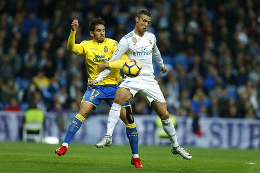 Real Madrid's Cristiano Ronaldo, right, battles for the ball with Las Palmas' Pedro Bigas during the Spanish La Liga soccer match between Real Madrid and Las Palmas at the Santiago Bernabeu stadium in Madrid, Sunday, Nov. 5, 2017.