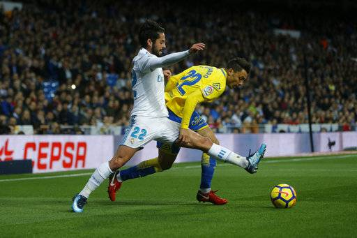 "Real Madrid's Francisco Roman ""Isco"", left, vies for the ball with Las Palmas' Joaquin ""Ximo"" Navarro during the Spanish La Liga soccer match between Real Madrid and Las Palmas at the Santiago Bernabeu stadium in Madrid, Sunday, Nov. 5, 2017."