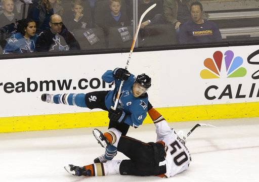 San Jose Sharks center Joe Pavelski, top, is pulled down by Anaheim Ducks center Antoine Vermette (50) during the first period of an NHL hockey game in San Jose, Calif., Saturday, Nov. 4, 2017.