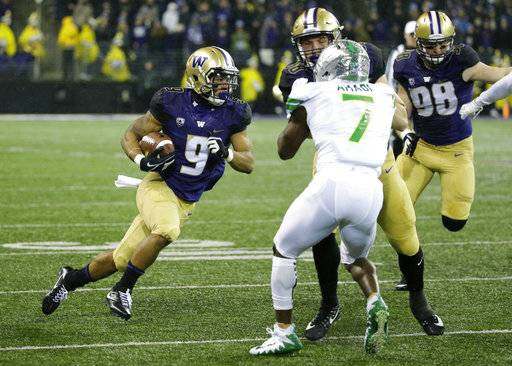 Washington running back Myles Gaskin (9) runs for a touchdown against Oregon in the first half of an NCAA college football game, Saturday, Nov. 4, 2017, in Seattle.