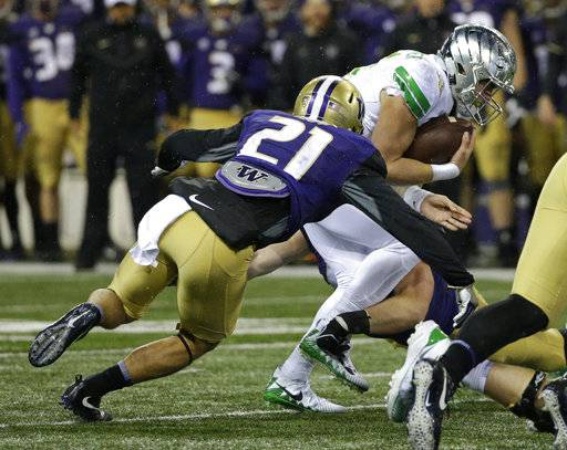 Oregon quarterback Braxton Burmeister, right, is tackled by Washington's Taylor Rapp (21) in the first half of an NCAA college football game, Saturday, Nov. 4, 2017, in Seattle.