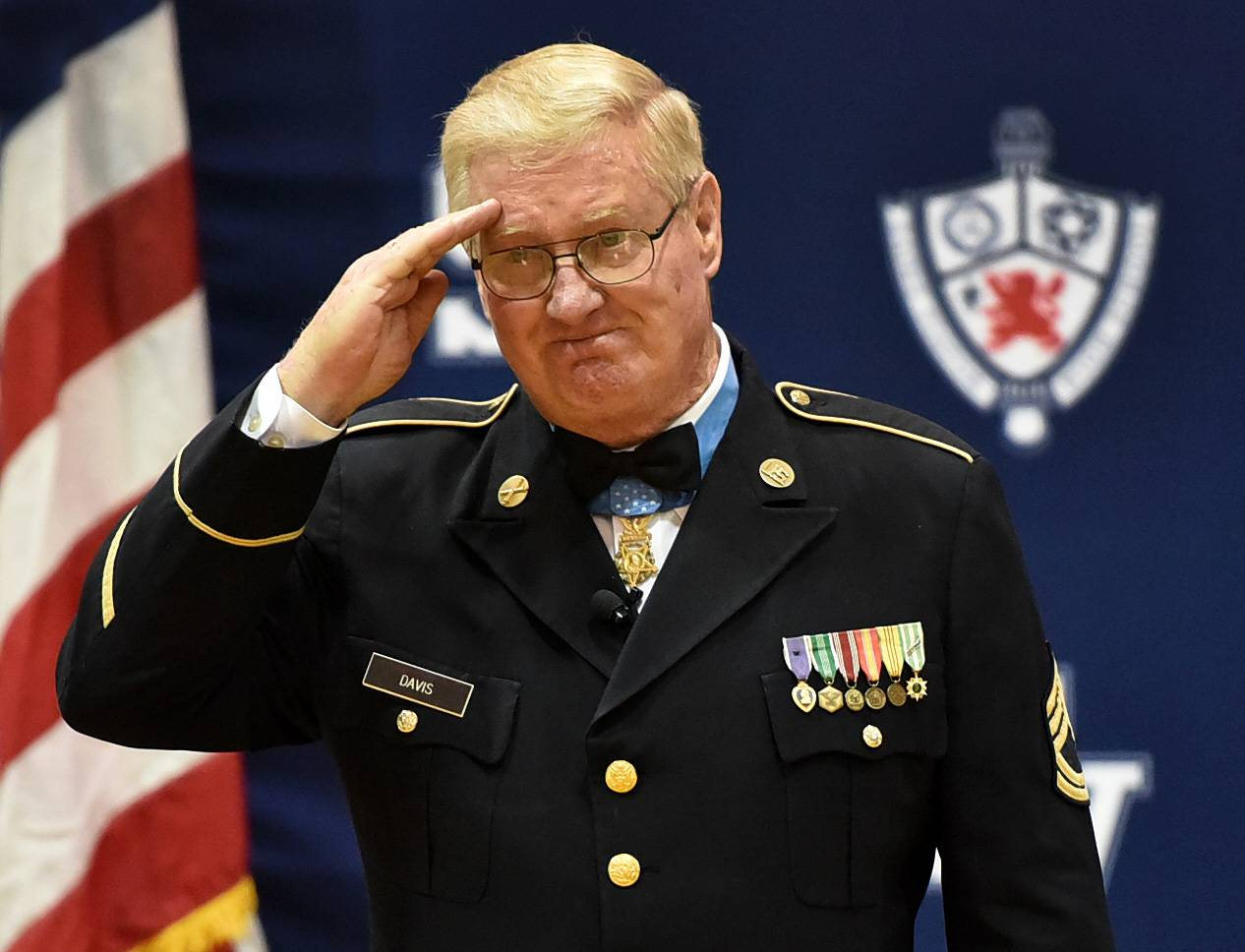 Retired Army Sgt. Sammy L. Davis, known as the real Forrest Gump, salutes the crowd Monday during a visit with students at St. Viator High School in Arlington Heights.