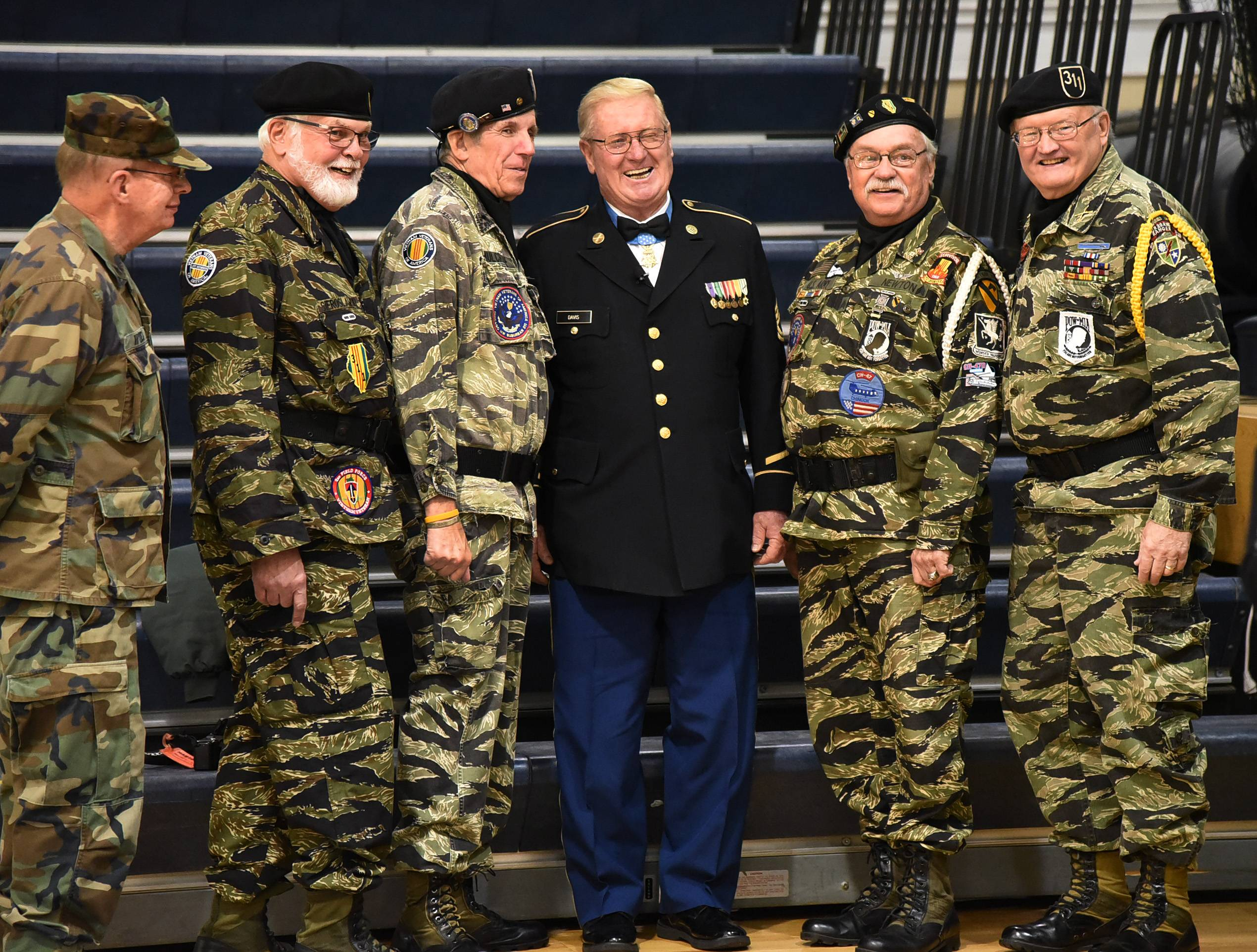 Retired Army Sgt. Sammy L. Davis, also known as the real Forrest Gump, poses with the color guard Monday while visiting St. Viator High School in Arlington Heights.