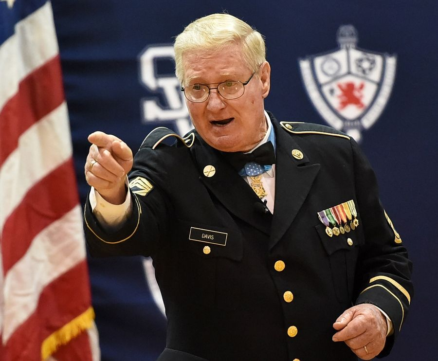 Retired Army Sgt. Sammy L. Davis answers questions from students Monday while visiting St. Viator High School in Arlington Heights.