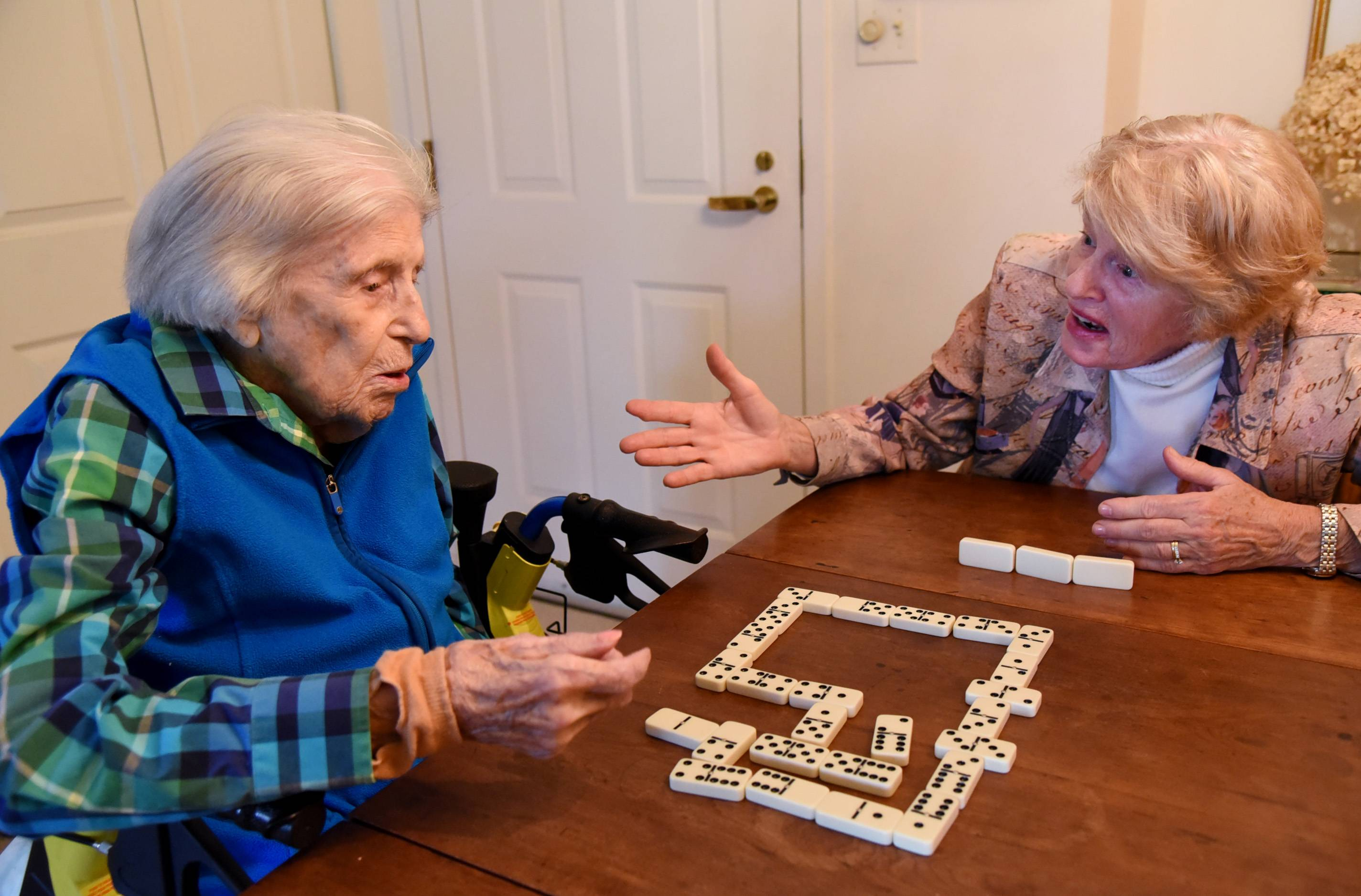 At nearly 110 years old, Lois Arbanas still enjoys beating her daughter, Anne Feichter of Elk Grove Village, in a good game of dominoes.