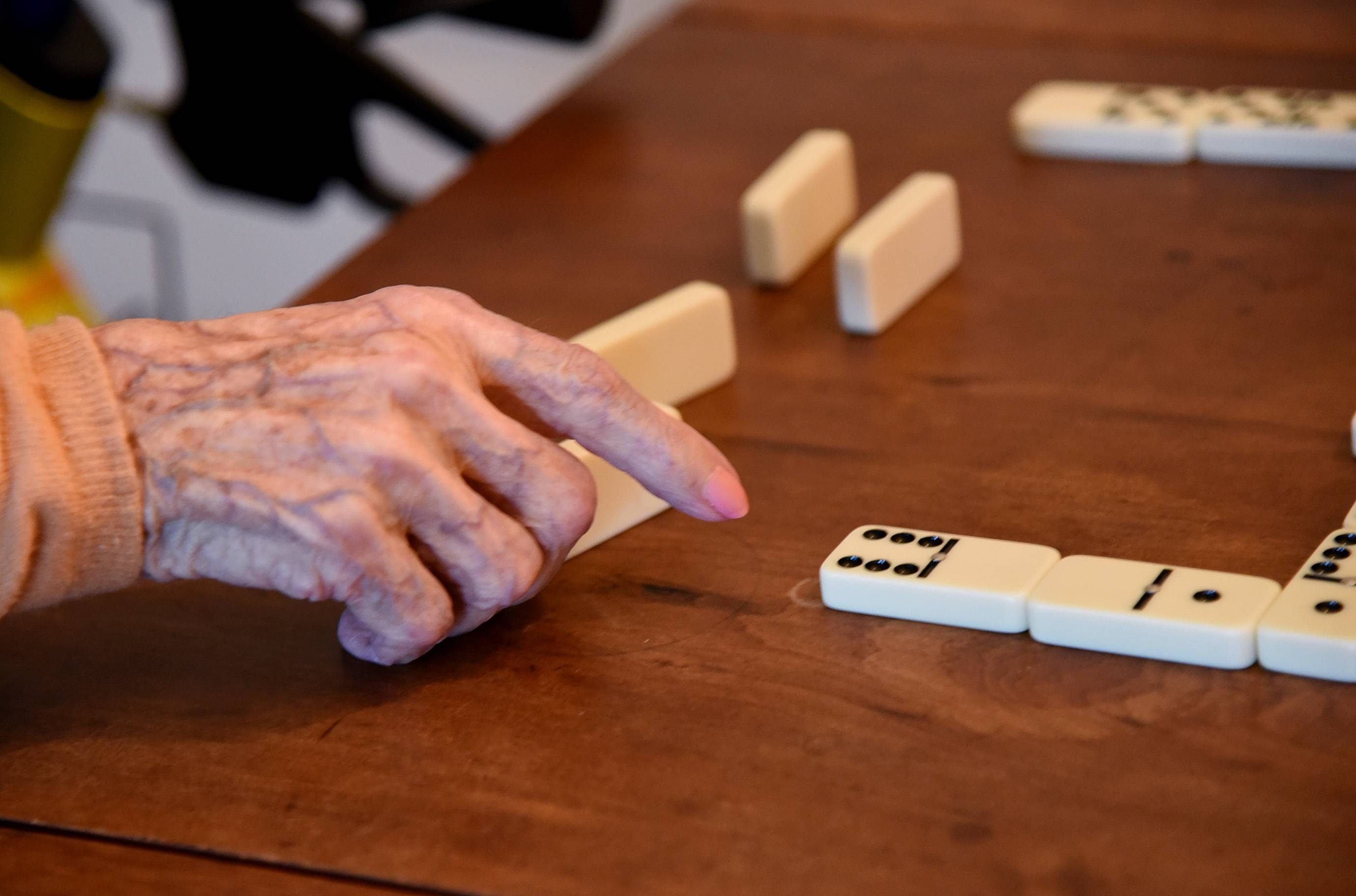 Lois Arbanas, who turns 110 on Dec. 1, plays dominoes at her Arlington Heights home with her daughter, Anne Feichter of Elk Grove Village.