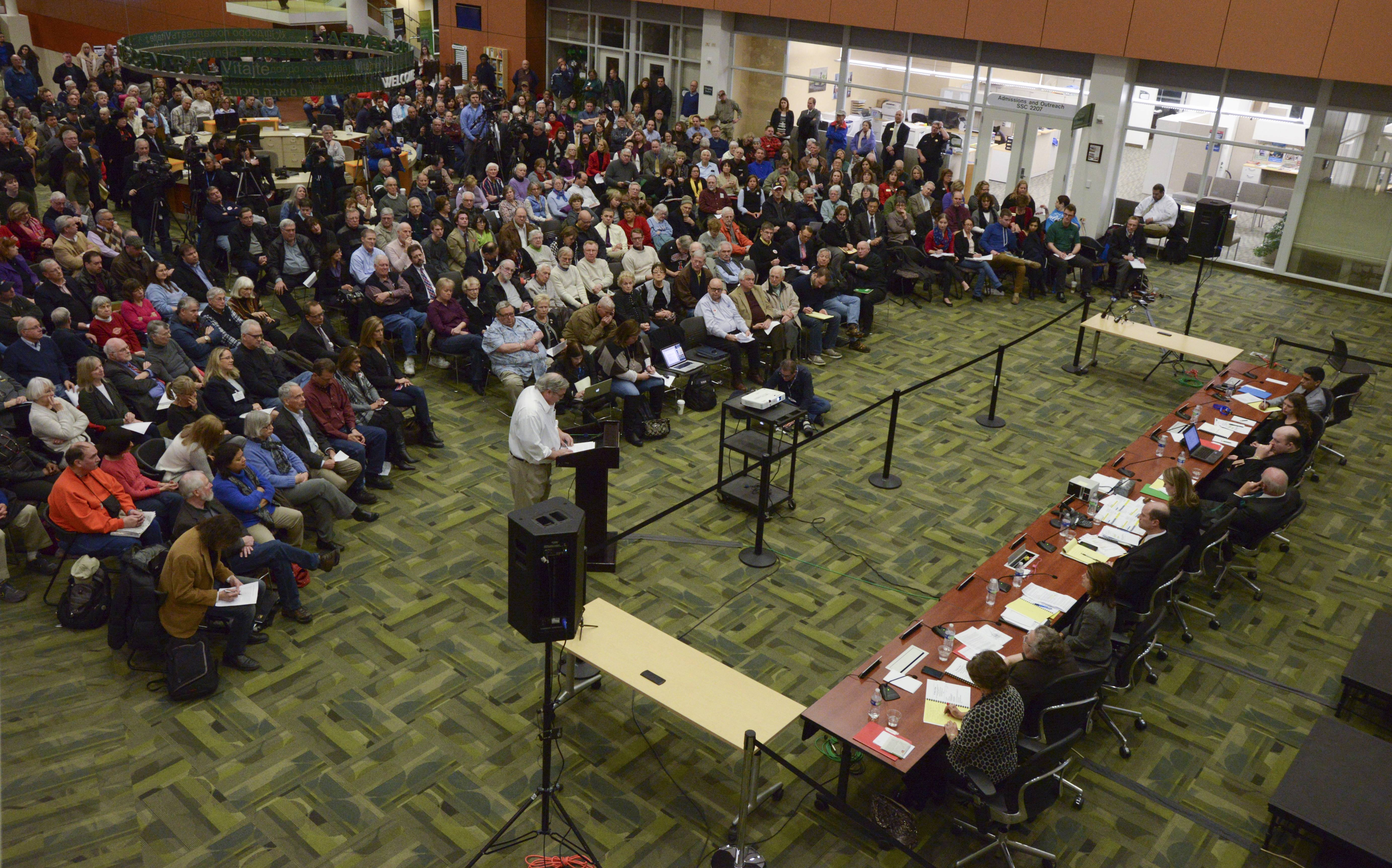 More than 300 people attended the January 2015 meeting where College of DuPage trustees approved a $763,000 retirement buyout of former school President Robert Breuder's contract.