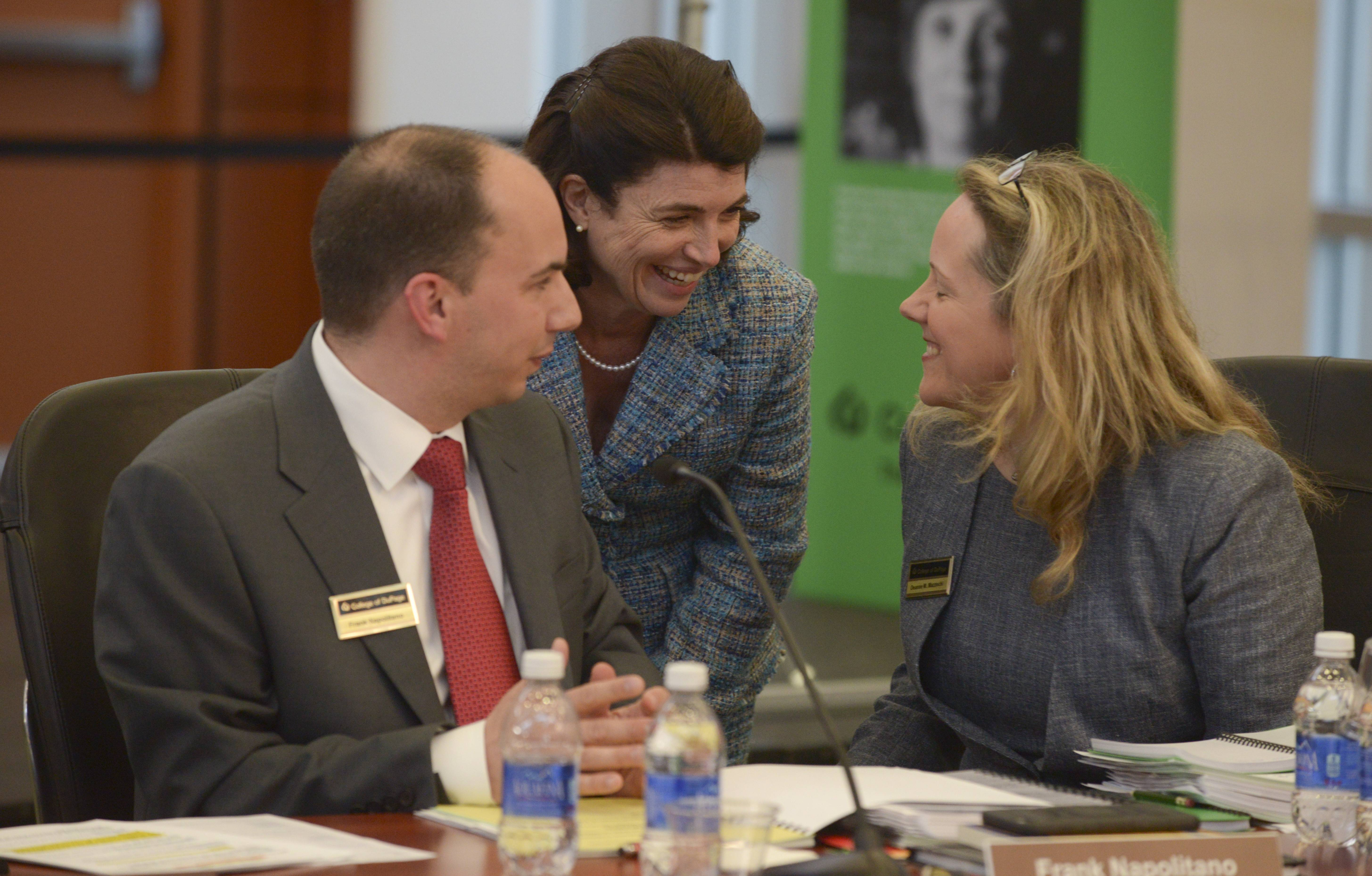 Kathy Hamilton, center, speaks with Frank Napolitano and Deanne Mazzochi during Napolitano's and Mazzochi's first College of DuPage board meeting after being elected to the panel in April 2015.
