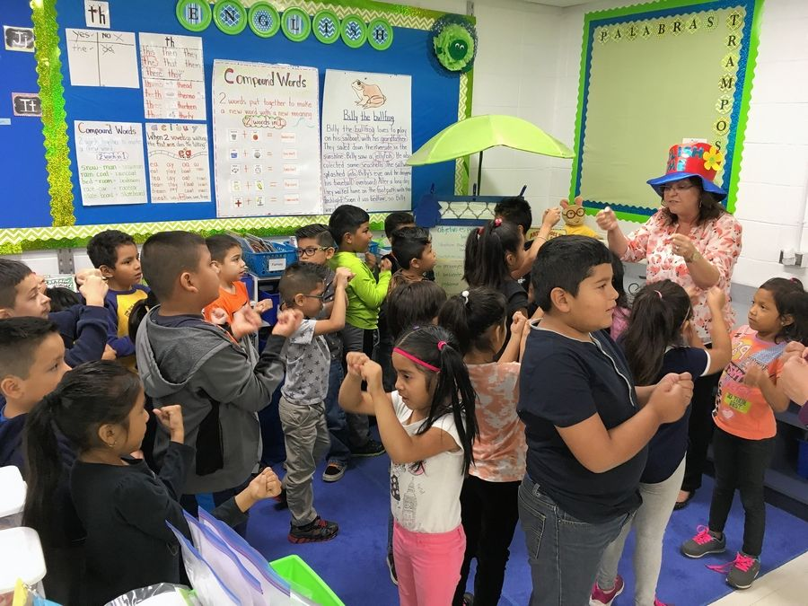 First- and second-grade students in Manely Rojas' class in Elk Grove Township District 59 learn new English words using hand gestures.