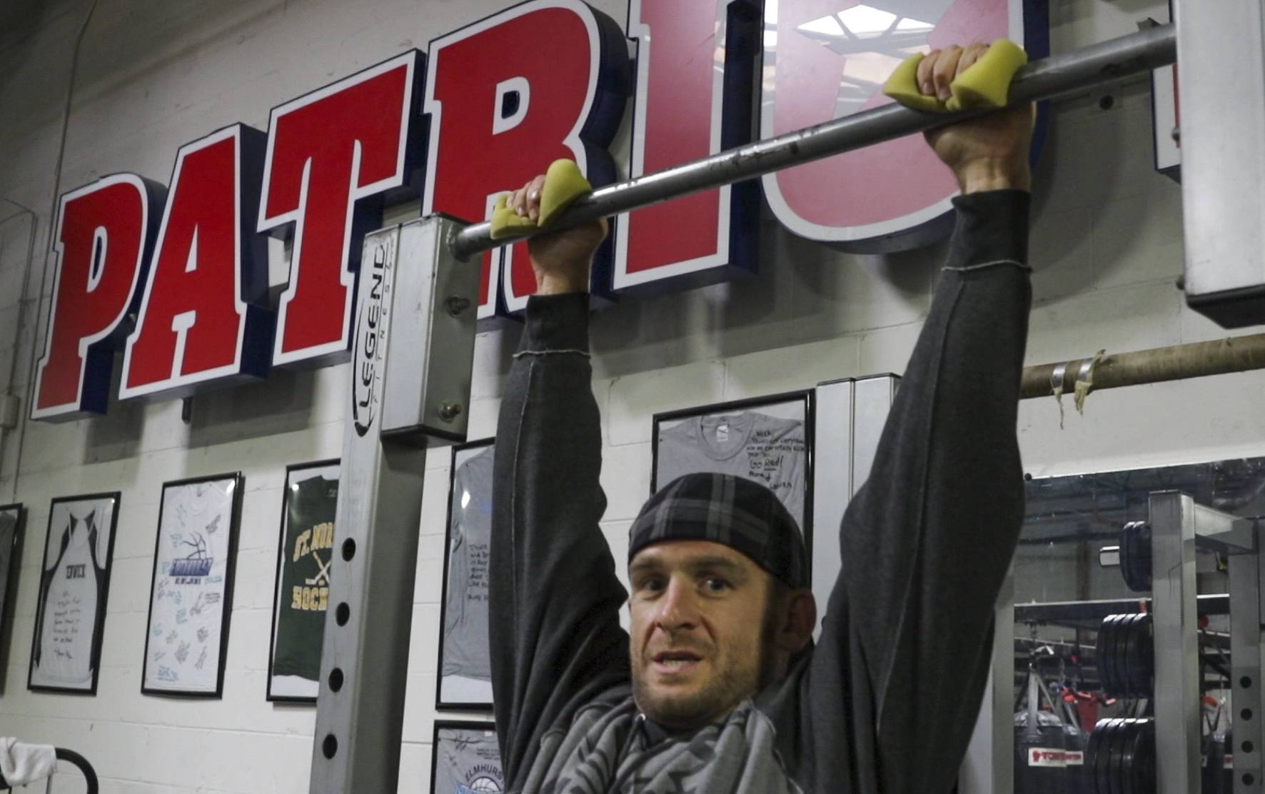 Nick Janowitz, owner of Patriot Sports and Fitness in Elmhurst, does pull-ups during one of his first workouts a week after setting what he believes is a new world record for most pullups in a 24-hour period with 7,621.