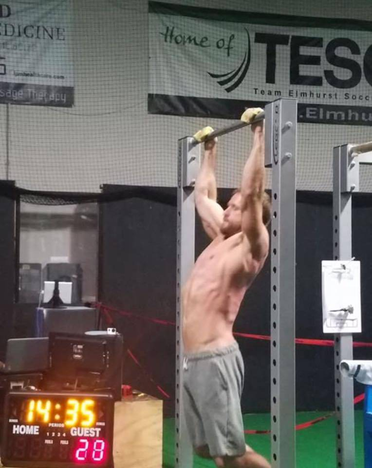 Elmhurst gym owner Nick Janowitz completes one of the 7,621 pull-ups he finished in 18 hours to set what he believes is a new world record on Oct. 27, his 37th birthday.