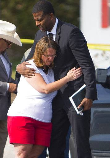 Sherri Pomeroy, wife of Pastor Frank Pomeroy, who lost their daughter in Sunday's shooting at the First Baptist Church of Sutherland Springs, Texas, hugs Pastor Dimas Salaberrios before a news conference down the street from the church, Monday, Nov. 6, 2017, in Sutherland Springs, Texas. (Mark Mulligan/Houston Chronicle via AP)