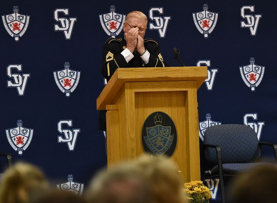 "Known as ""the real Forrest Gump"" for his heroism during the Vietnam War, retired Army Sgt. Sammy L. Davis played the harmonica Monday while visiting St. Viator High School in Arlington Heights."