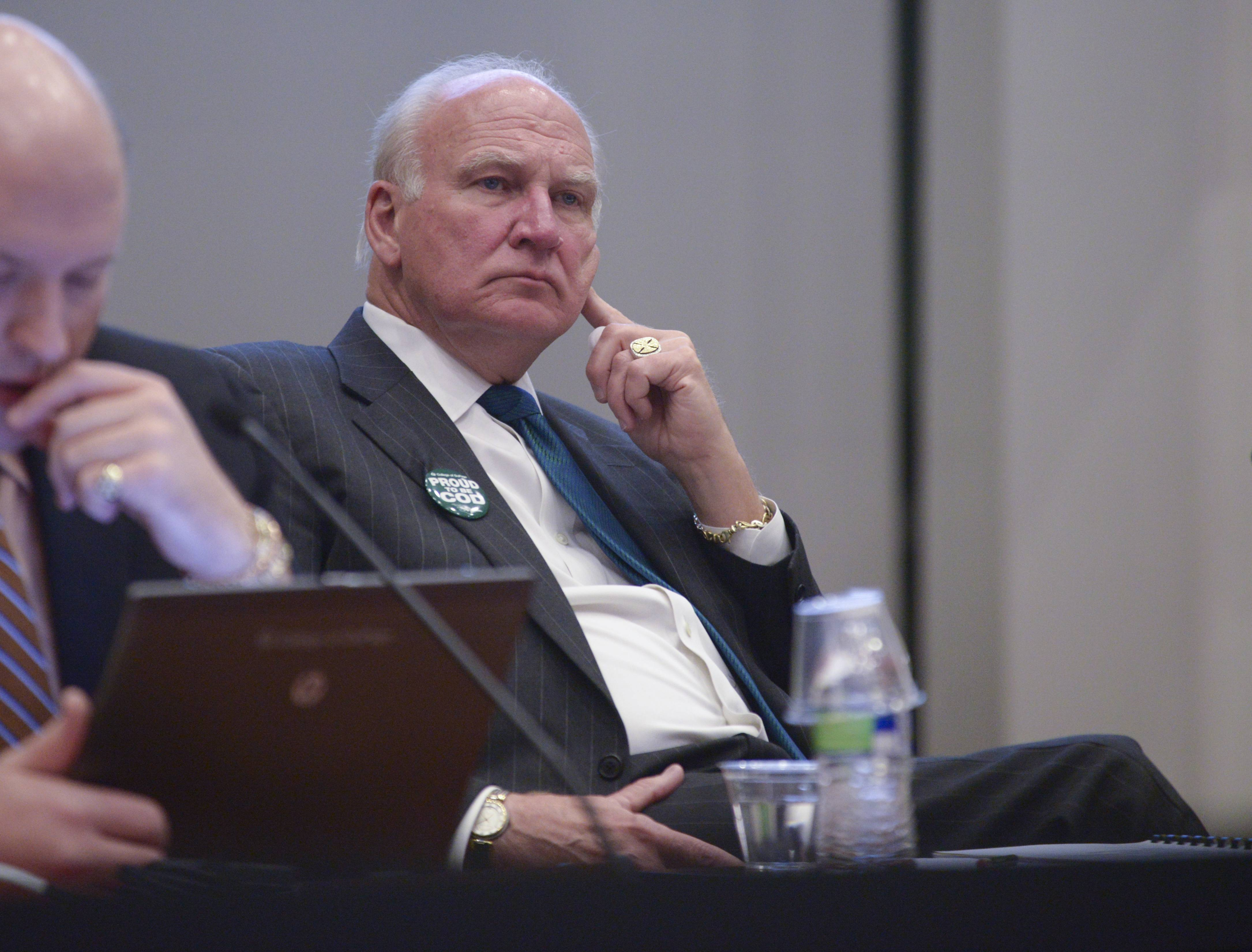 Former College of DuPage President Robert Breuder listened to the residents speak out against the $763,000 buyout of his contract before the deal was approved in January 2015.