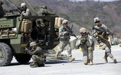 FILE - In this March 25, 2015, file photo, U.S. Army soldiers from the 25th Infantry Division's 2nd Stryker Brigade Combat Team and South Korean soldiers take their position during a demonstration of the combined arms live-fire exercise as a part of the annual joint military exercise Foal Eagle between South Korea and the United States at the Rodriquez Multi-Purpose Range Complex in Pocheon, north of Seoul, South Korea. President Donald Trump visits South Korea on Tuesday, Nov. 7, 2017, on the second leg of his first official Asian tour. While Trump will be looking to use his trip to strengthen Washington's alliance with Seoul and reaffirm their joint push to maximize pressure on North Korea over its nuclear program, he will also be faced with several thorny issues weighing on the relationship.