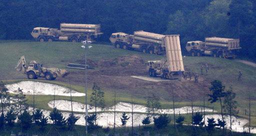 FILE - In this Sept. 7, 2017, file photo, U.S. missile defense system called Terminal High-Altitude Area Defense system, or THAAD, are seen at a golf course in Seongju, South Korea. President Donald Trump visits South Korea on Tuesday, Nov. 7, 2017, on the second leg of his first official Asian tour. While Trump will be looking to use his trip to strengthen Washington's alliance with Seoul and reaffirm their joint push to maximize pressure on North Korea over its nuclear program, he will also be faced with several thorny issues weighing on the relationship. (Kim Jun-beom/Yonhap via AP, File)