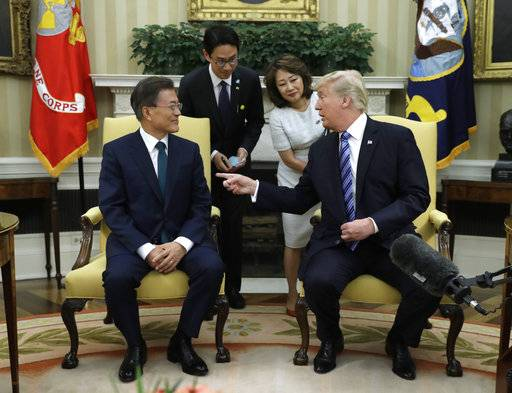 FILE - In this June 30, 2017, file photo, U.S. President Donald Trump, right, meets with South Korean President Moon Jae-in in the Oval Office of the White House in Washington, Friday, June 30, 2017. President Donald Trump visits South Korea on Tuesday on the second leg of his first official Asian tour. While Trump will be looking to use his trip to strengthen Washington's alliance with Seoul and reaffirm their joint push to maximize pressure on North Korea over its nuclear program, he will also be faced with several thorny issues weighing on the relationship.