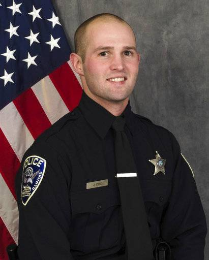 "This undated photo provided by the Rockford Police Department shows Rockford Police Officer Jamie Cox. Cox died during a traffic stop Sunday, Nov. 5, 2017 in Rockford, Ill. Authorities say Cox and another man were both found dead at the scene of a single-vehicle crash. Rockford police Chief Dan O'Shea says Cox became ""entangled"" with the car and fired a shot, but he declined to say how either man died or to provide additional details. (Rockford Police Department via AP)"